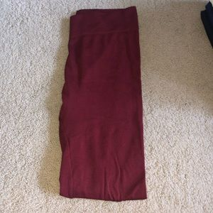 Maroon colored tights.